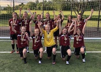 Under 14's Girls' Football Team crowned Surrey champions!